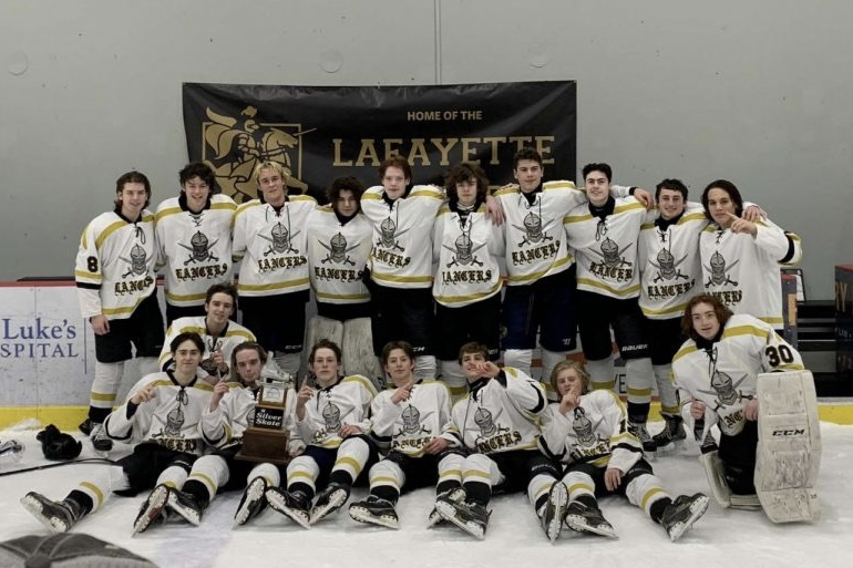 The Lancers pose after winning the Silver Skate game against Marquette on Dec. 31. It was their first win in the annual event against the Mustangs in six years.