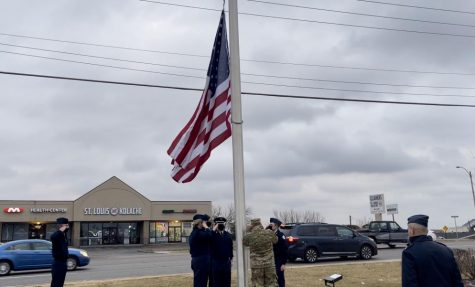 ROTC sponsors Lt. Col. Jim Smith, Mst. Sgt. Matt Zahradka, and their students raise a new flag for the Mobile On The Run gas located at 14807 Manchester Road in Ballwin.