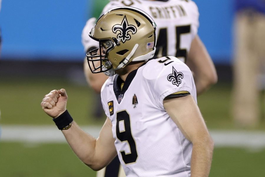 Quarterback Drew Brees (9) of the New Orleans Saints reacts after throwing a touchdown pass during the second half of their game against the Carolina Panthers at Bank of America Stadium on January 03, 2021 in Charlotte, North Carolina. (Jared C. Tilton/Getty Images/TNS)