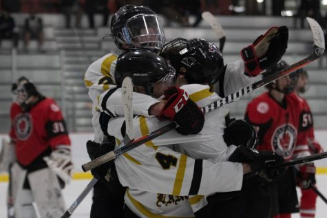 Members of the Lancer hockey team celebrate after a goal against their opponents, Chaminade, in the third game of the Challenge Cup Round Robin playoffs. The Lancers won the game, 3-2.
