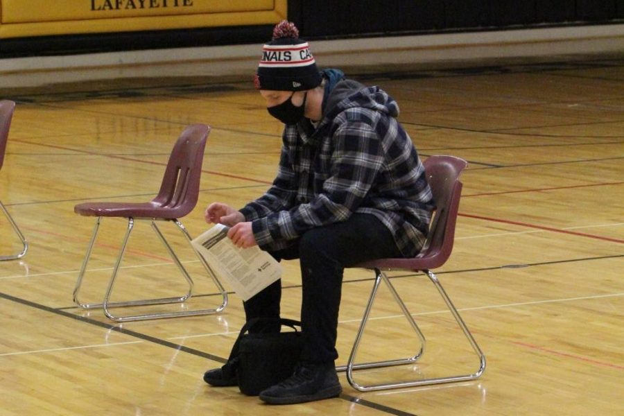 Senior Josh Moellenhoff waits to get signed in so he can donate at the Student Council Blood Drive on Feb. 12. He was one of 40 first-time donors  who participated.