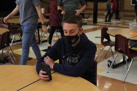 Freshman Ian Branson sits at a table during his lunch period. After returning to in-person school, Branson had to adjust to a new kind of lunch with limited seating.
