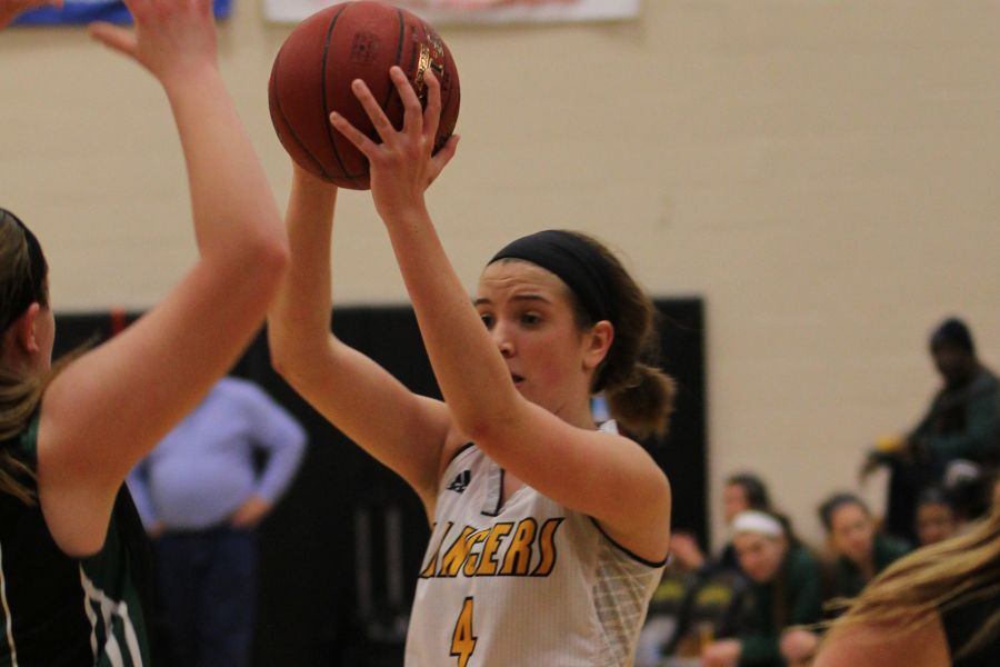 Tara Robbe (4) looks for an open teammate in a game against Mehlville. She scored 13 points and racked up five rebounds in a 65-36 victory.