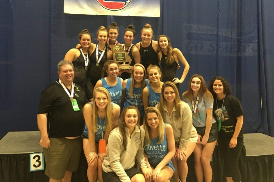 The+girls+swimming+and+diving+team+poses+after+their+first+place+State+win.