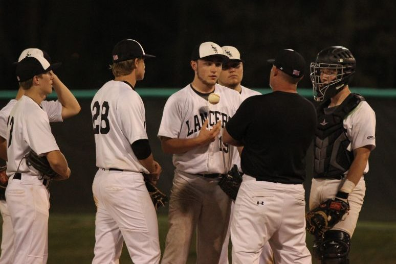 Head Coach Scott DeNoyer talks with Ryan O'Connell (10) on the mound during a game against Marquette. The Lancers would go on to lose to the game 11-3.