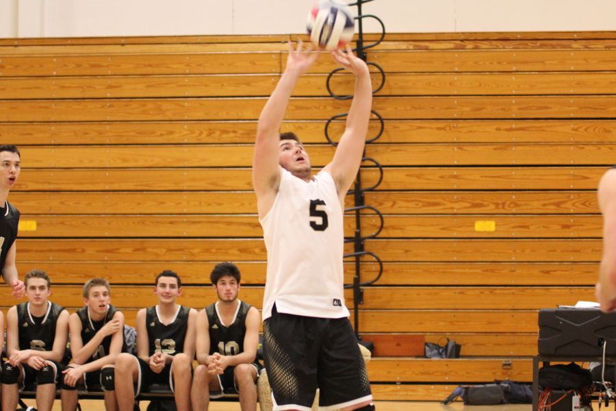 Dan Peipert sets the ball in a game against Fox. The Lancers would go on to win the contest 25-5, 25-7.