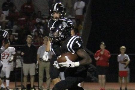 Attempting to gain yards, senior Jamal Martin runs the ball up the field. Martin has played a large role in the Lancers success. He currently has 197 total yards, two interceptions and one touchdown.