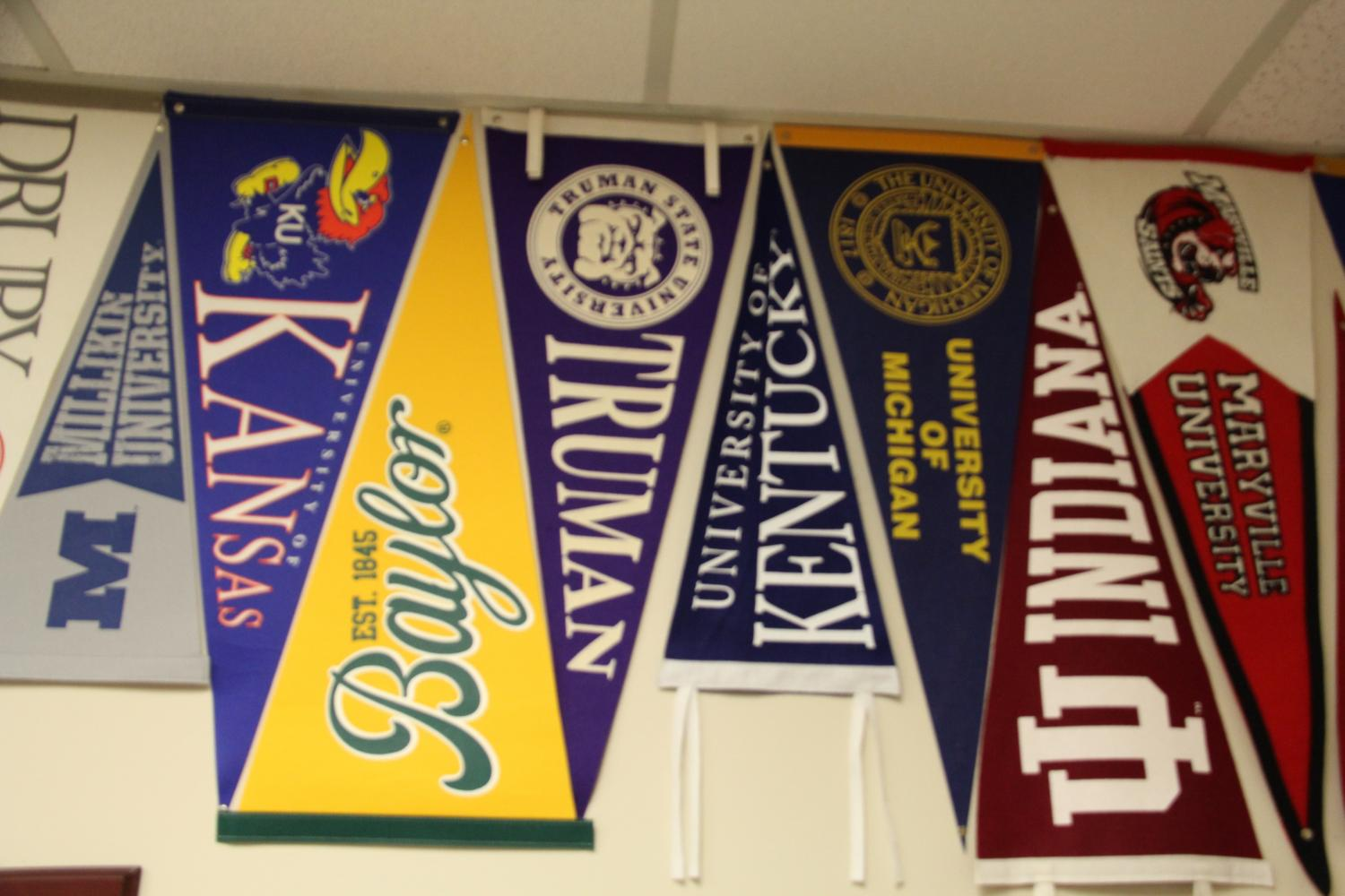 College counselor, Cheryl Egan, represents multiple colleges by putting flags on her office wall.