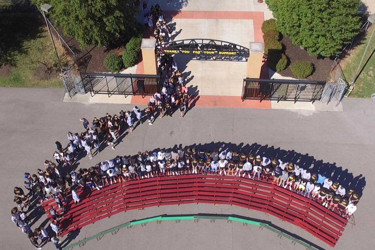 After lining up in the parking lot, the Class of 2018 makes their way into temporary bleachers to take the panoramic picture.