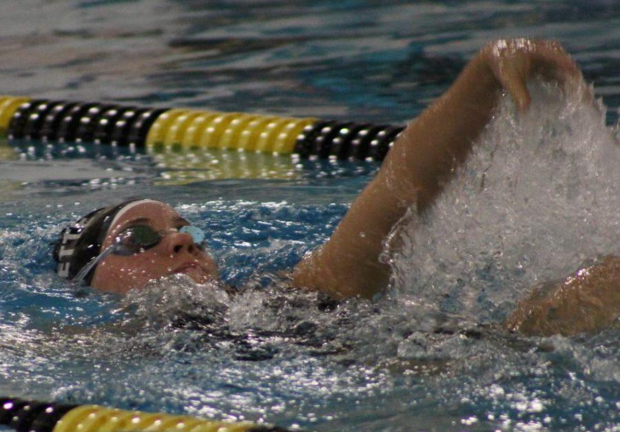 Sophomore Claire Van Biljon competes in the backstroke during a meet against Ladue High School.