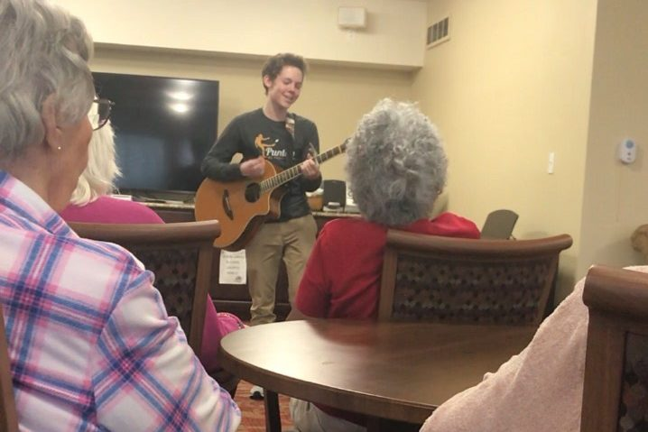 Sophomore Nick Berry sings Introducing Me at Autumn View Gardens retirement home.