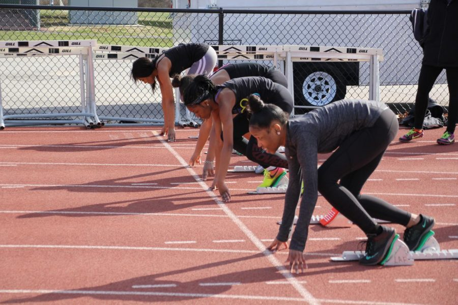 Lining+up+on+the+starting+blocks%2C+sophomore+Taleeya+Stewart+prepares+to+run+a+100-meter+dash.+
