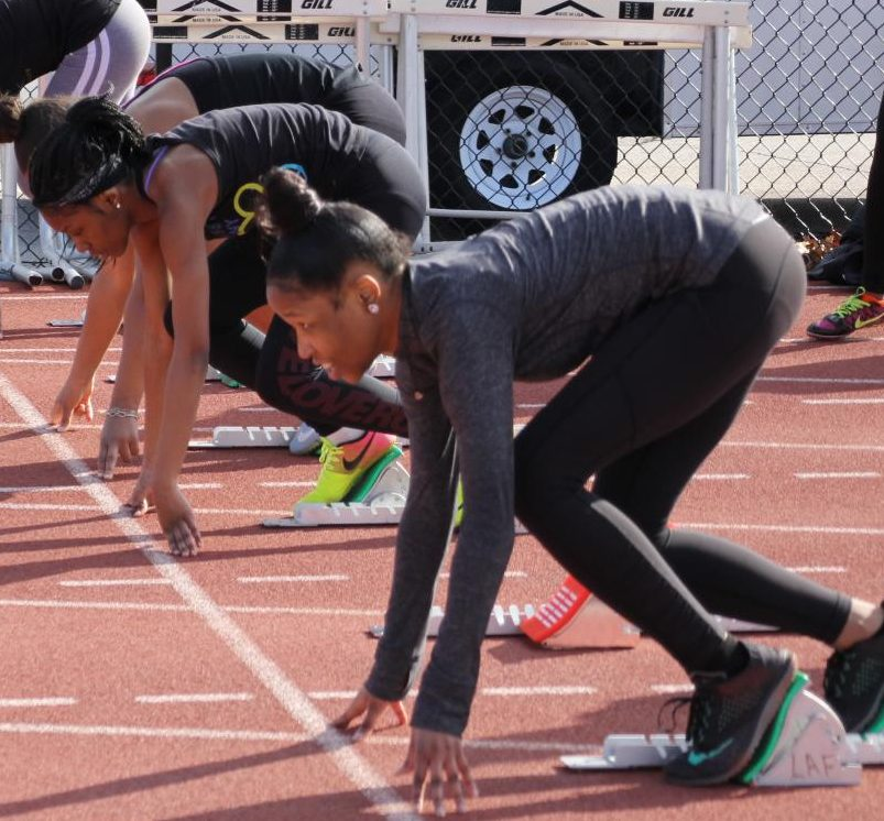 Lining up on the starting blocks, sophomore Taleeya Stewart prepares to run a 100-meter dash.