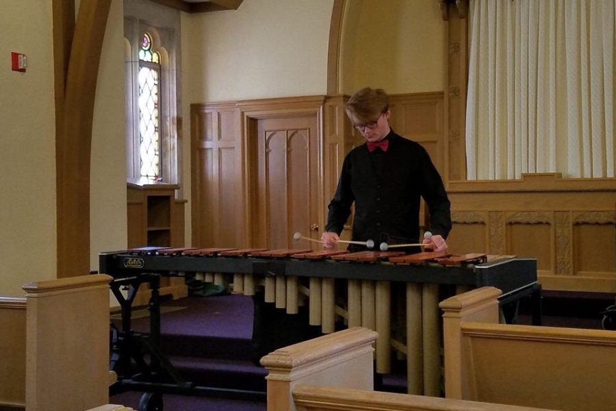 Junior Riley Berens performs marimba in front of the judges at the state solo and ensemble festival.