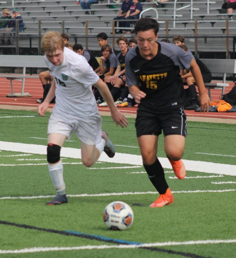 In+the+boys+soccer+team%27s+first+home+game+of+the+year%2C+junior+Sam+Londono+races+Pattonville+midfielder+Kyle+Campbell+to+the+ball.+The+Lancers+lost+the+game+1-0%2C+but+the+team+has+a+3-2+record.+