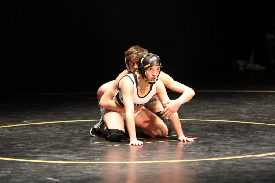 During the LHS Theater Show-down, freshman Faith Cole wrestles a Seckman wrestler. The Lady Lancers defeated the Jaguars 39-24.
