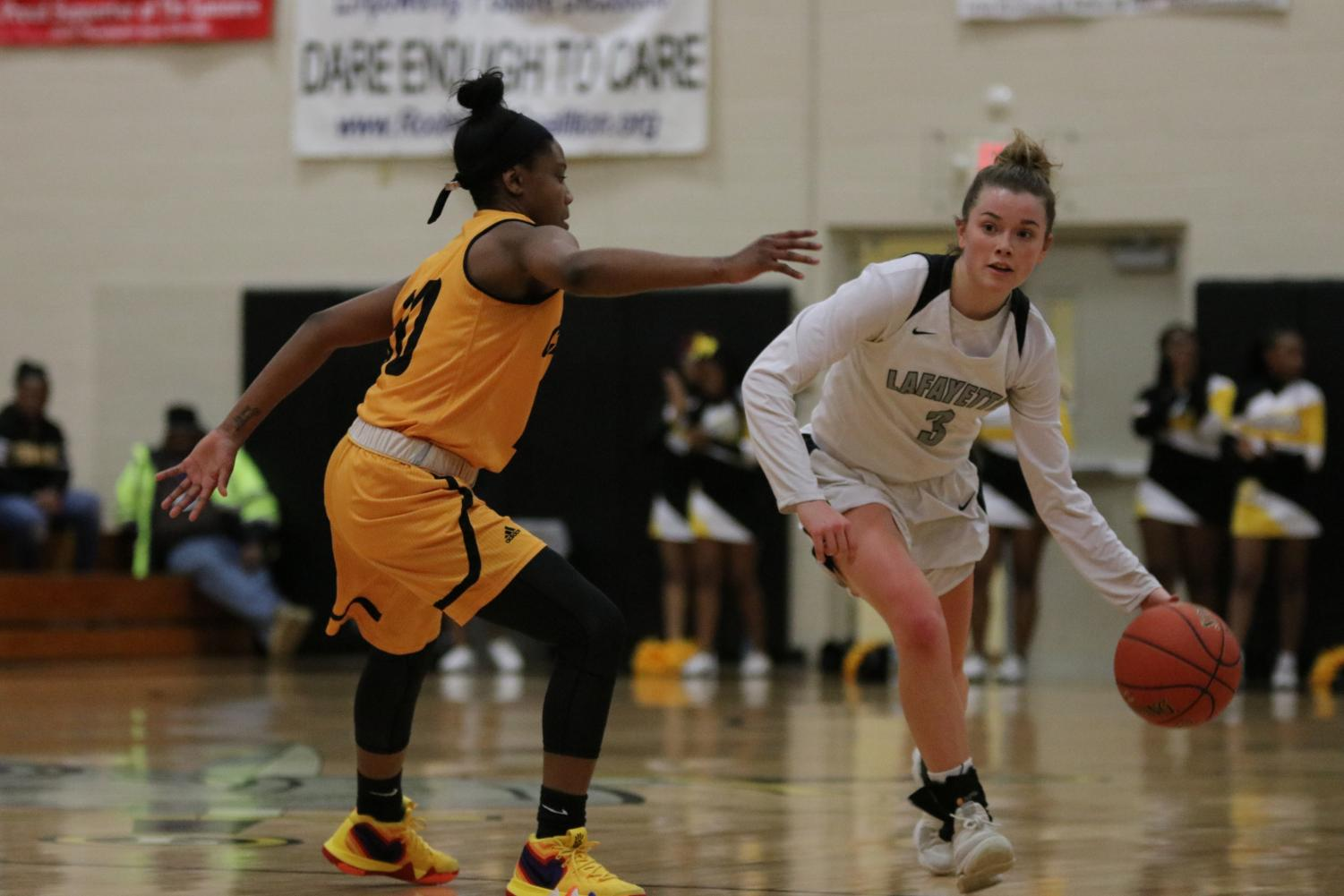 On the Jan. 9 game against Hazelwood Central, senior Sydnie Wolf dribbles the ball down the lane. The Lancers lost the game 48-41.