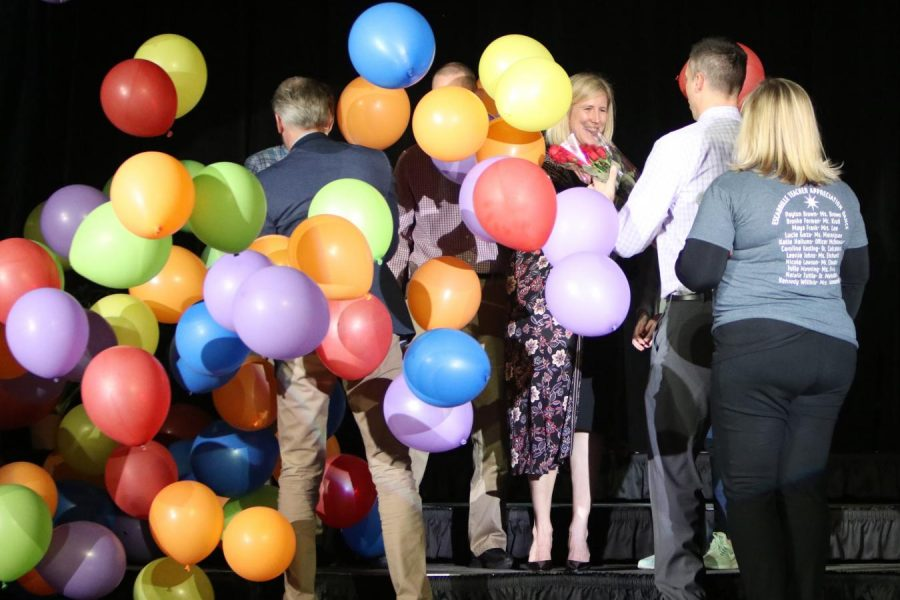 Balloons rain down on Librarian Nichole Ballard-Long and her family as she is recognized as the 2018-2019 Teacher of the Year. Ballard-Long has been working at Lafayette for the past 20 years.