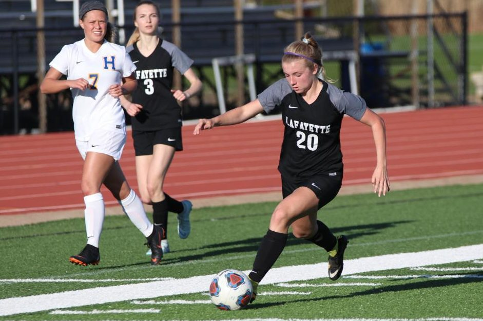 Rylee Howard pushes past the Francis Howell defense in order to move the ball down into the attacking area. The Lancers beat Howell 3-1 on April 8.