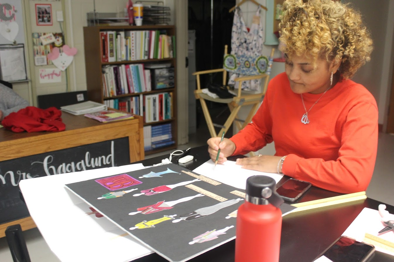 Junior Lauren Liggins works on her clothing designs during 4th hour Fashion Design and Merchandising.