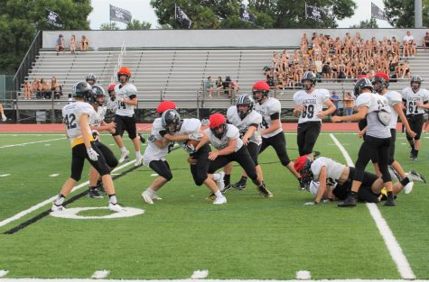 At the community event on Aug. 24, Lafayette junior varsity football scrimmaged against themselves, using red caps to represent defense.