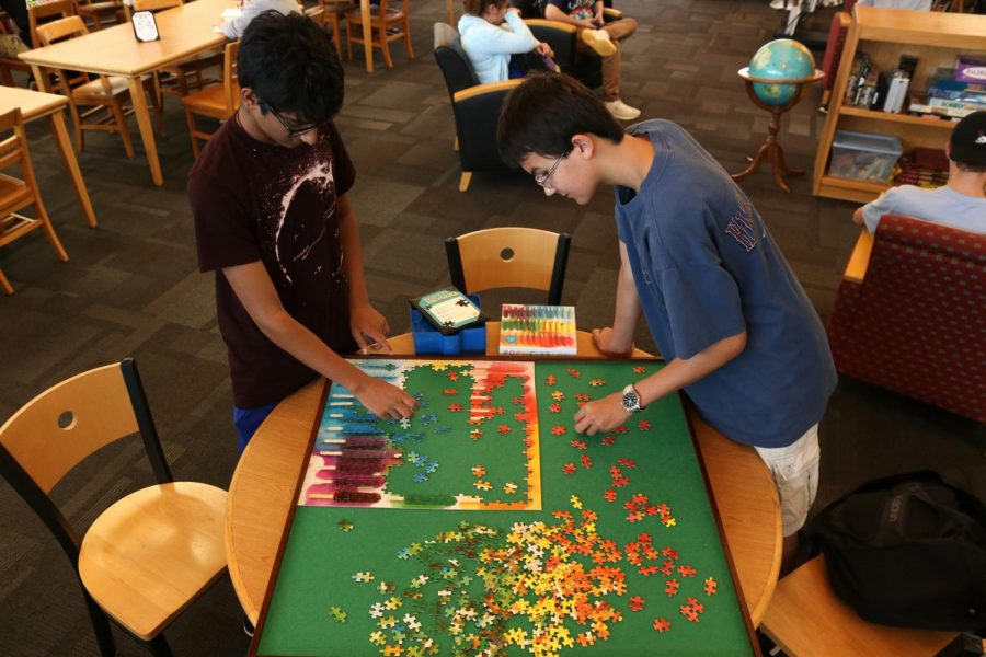 Current seniors Pranav Menon and Colin Bakker piece together a puzzle in the Library during their Flex Time in Aug. 2019. The library, amongst classrooms and other specified locations, can be selected by students to spend a section of their Academic Lab time in.