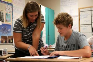 With a quiz later in the day, Matthew Haefner, freshman, studies with math teacher Katrina Clark.