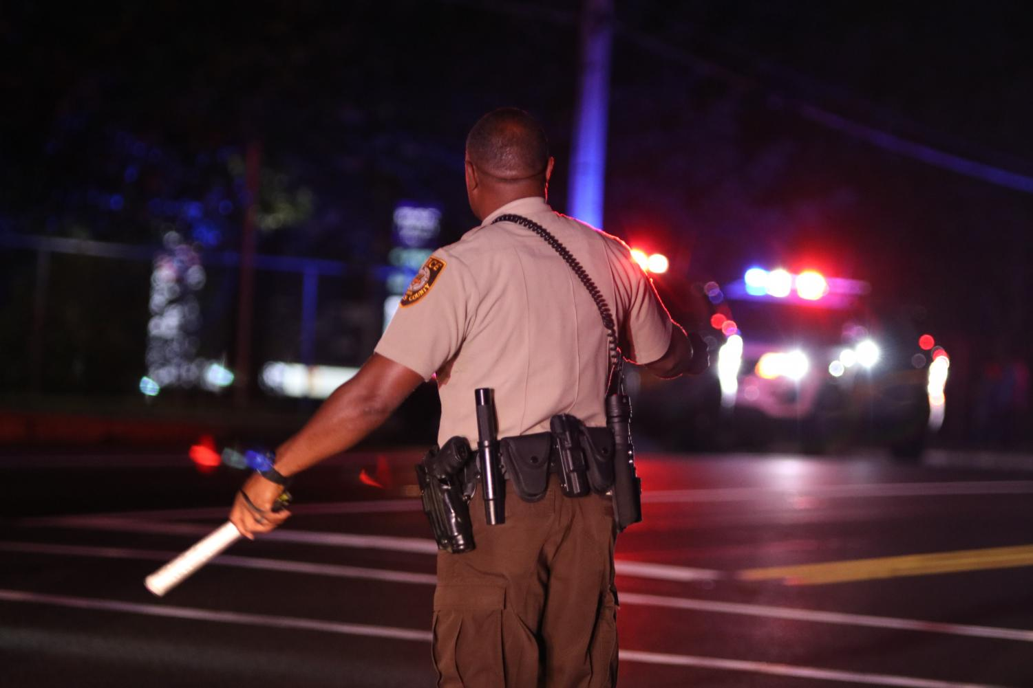 A St. Louis County police officer directs traffic after a shot was fired on Aug. 23 at Parkway North.