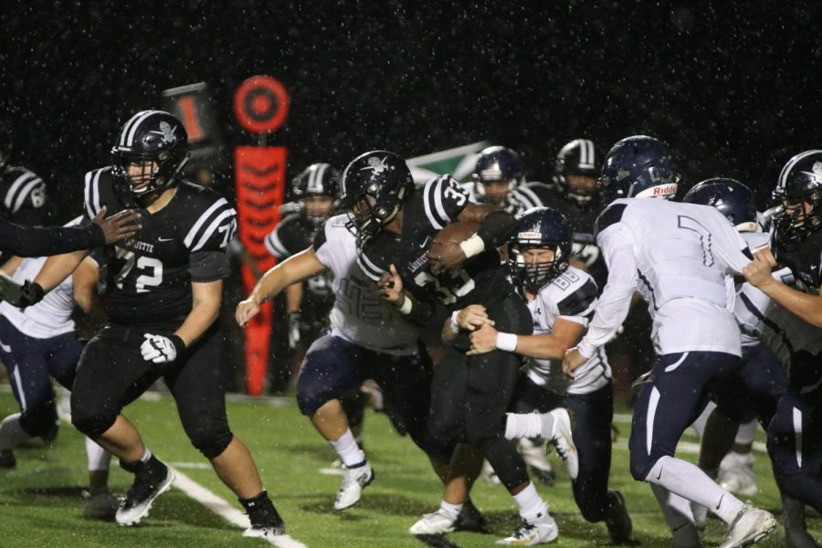 Running back Caden Phipps fights against Timberland's defensive line in the football home opener. He had 137 rushing yards and scored the first touchdown of the game. Lancers won the game 14-7.