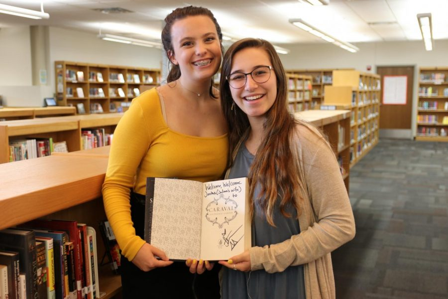 After meeting author Stephanie Garber, sophomores Anna Matusiak and Janka Gerber hold Gerber's signed copy.