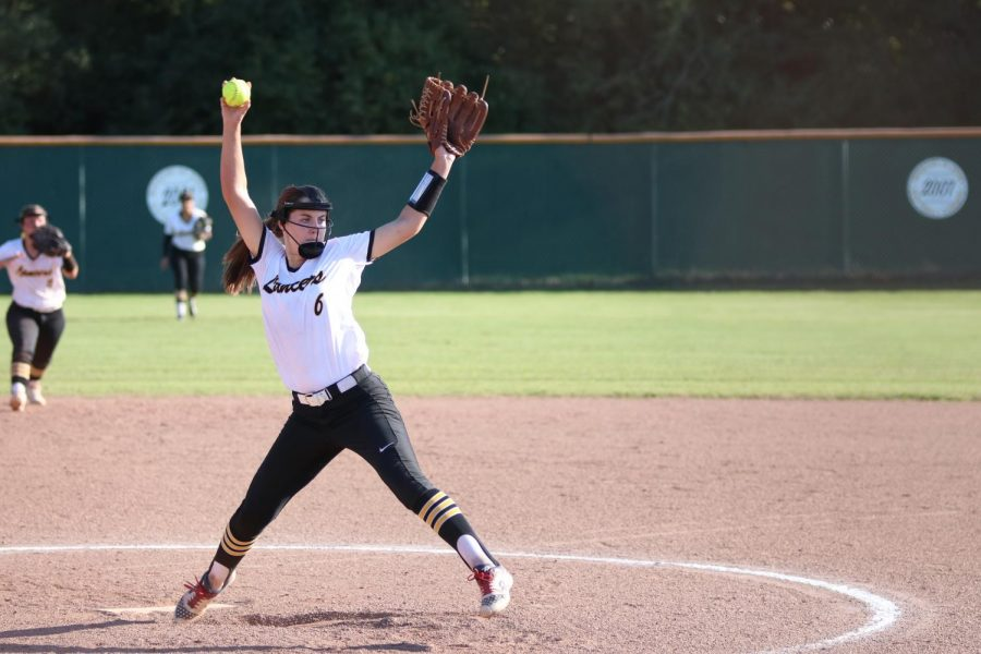 Sophomore Kaley Adzick winds up to pitch against Seckman. Adzick struck-out four batters in the game.