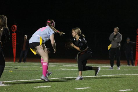Rachael Bierschenk dodges the juniors, scoring a touchdown for the seniors. Her touchdown helped strengthen the senior women's lead over the juniors.