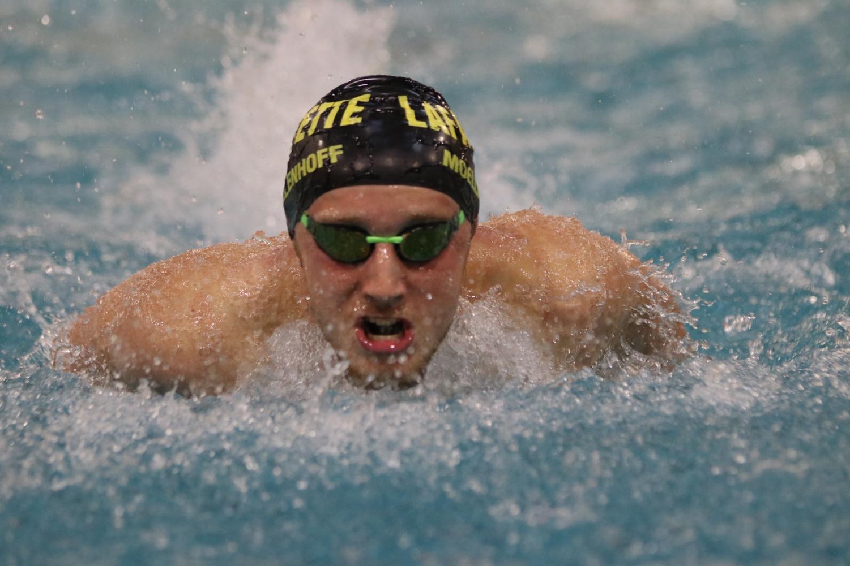 Joshua Moellenhoff, junior, swims during the meet against Eureka on Oct. 1.