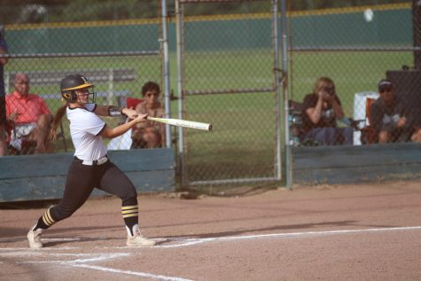 Infielder Lexi Brewer swings at a pitch during Lafayette