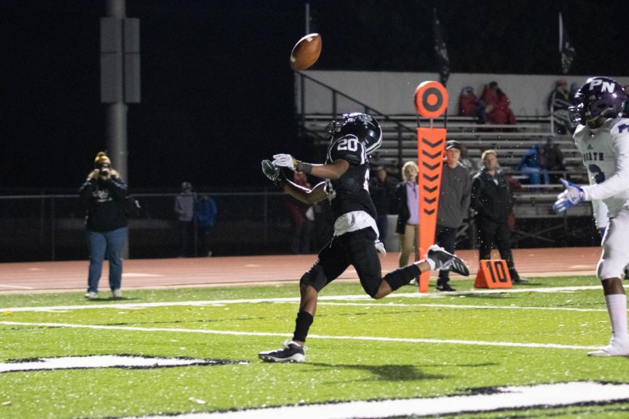 Junior Pernell Garner attempts to catch the ball during Lafayette's game against Parkway North. The Lancers won the game, 41-0.
