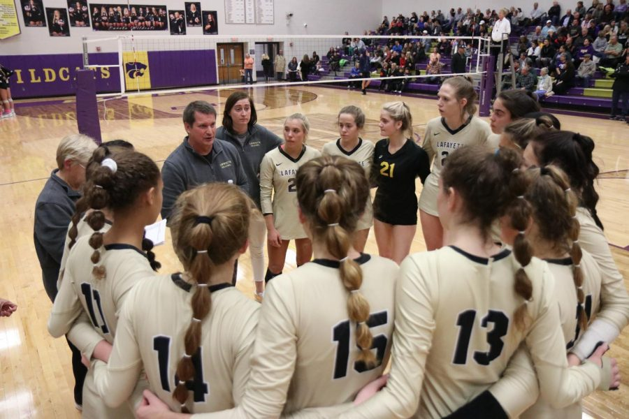 During a timeout in the District championship against the Eureka Wildcats on Oct. 30, Head Coach Zachary Young talks to his team. The Lancers won in two sets, and went on to beat Oakville and Cor Jesu on Nov. 2.
