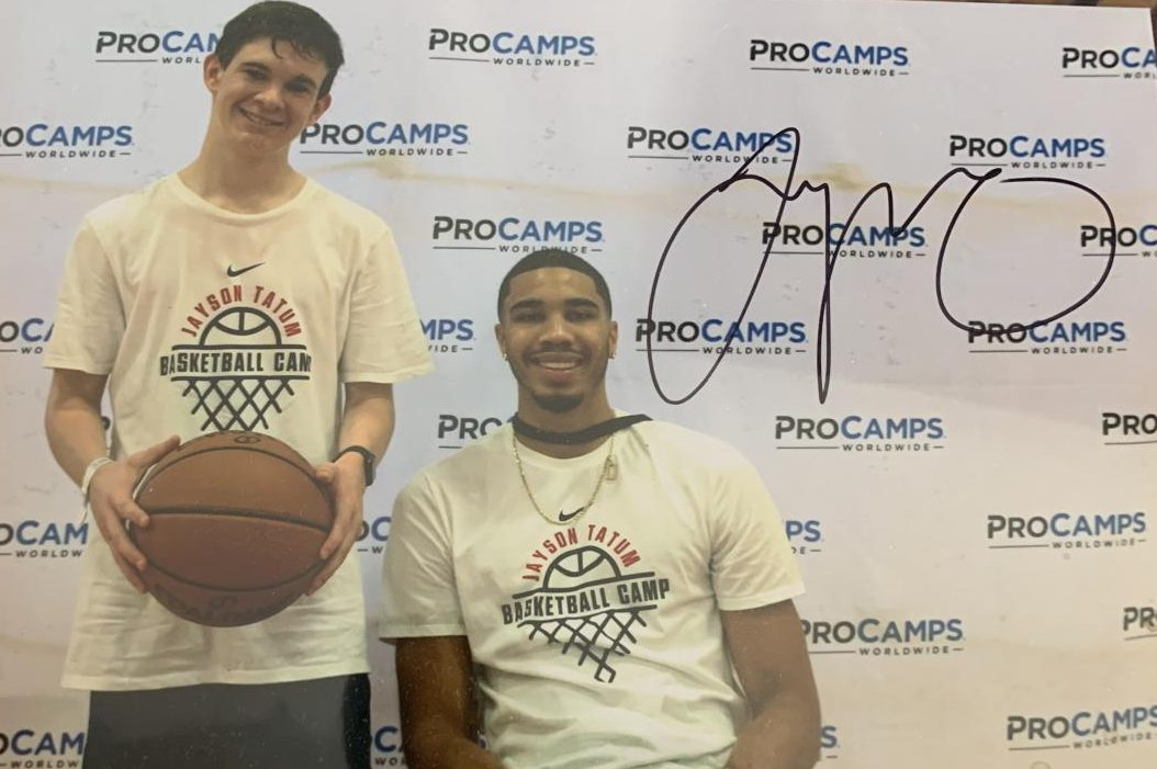 Sophmore Tom Richards poses with NBA star and St. Louis native Jayson Tatum.