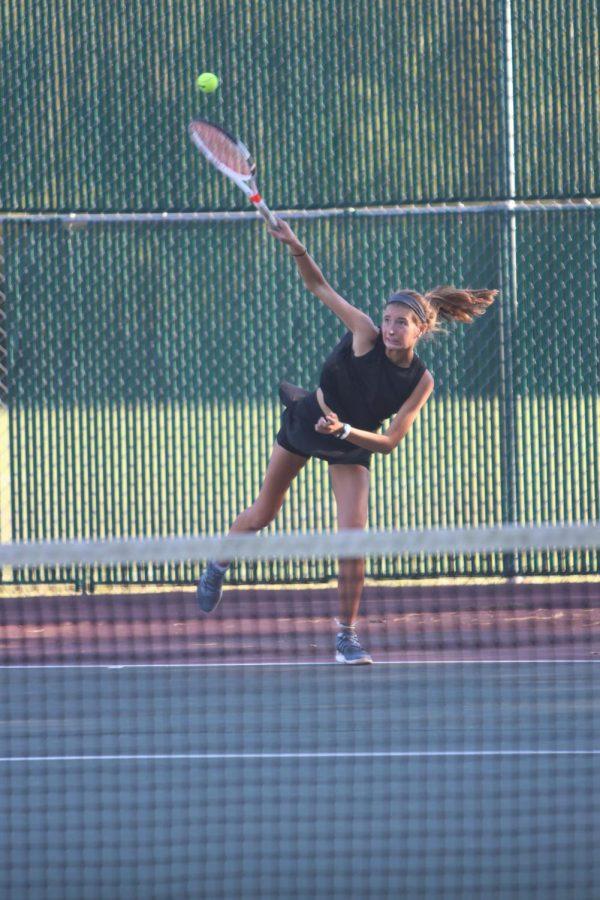Katie Ferguson returns the ball during a tennis match against St. Joseph's Academy.