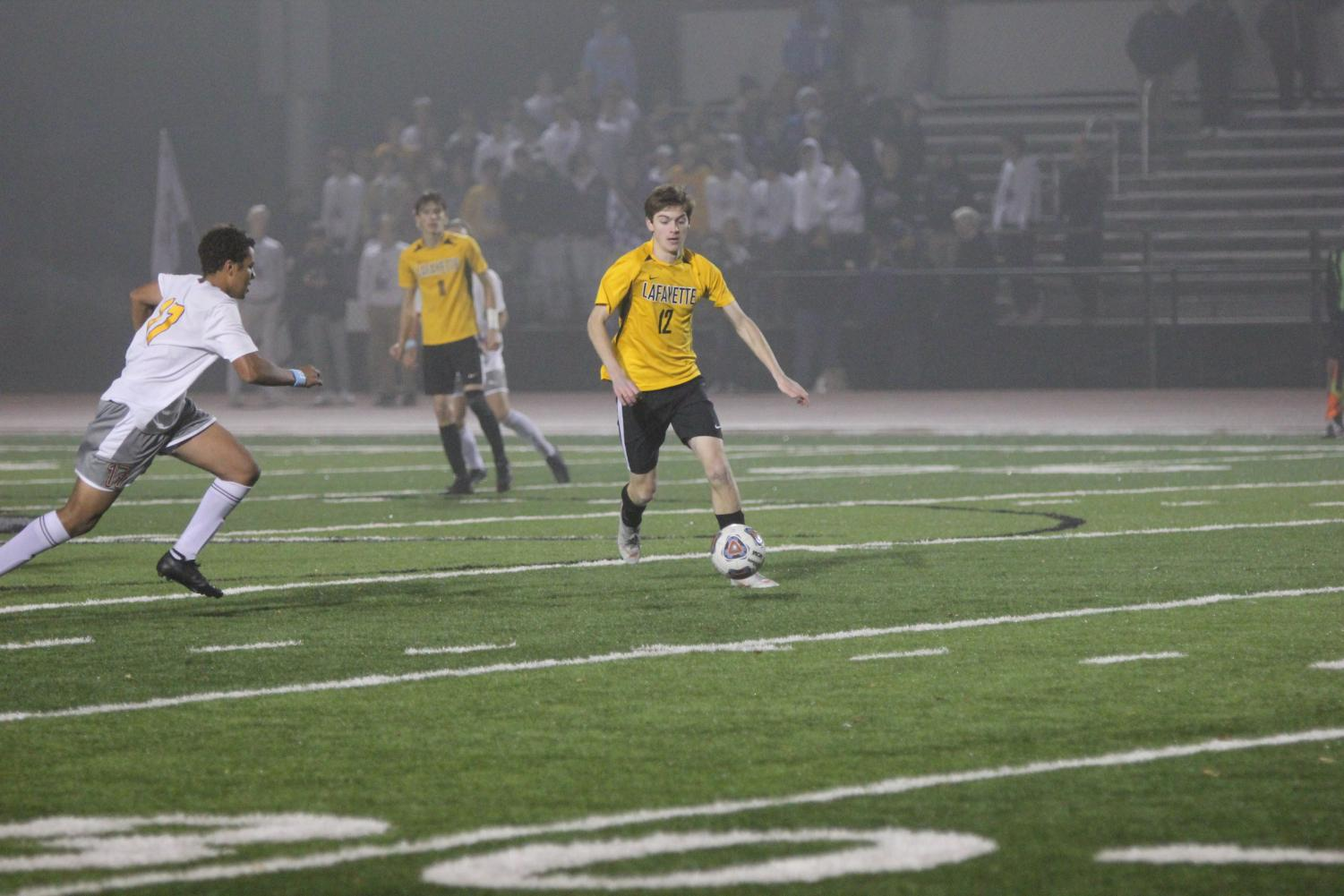 In the District Final, junior Mitchell Grant outruns a CBC defender. The Lancers lost the game, 1-0 in overtime, and ended the season with a record of 18-7-1.