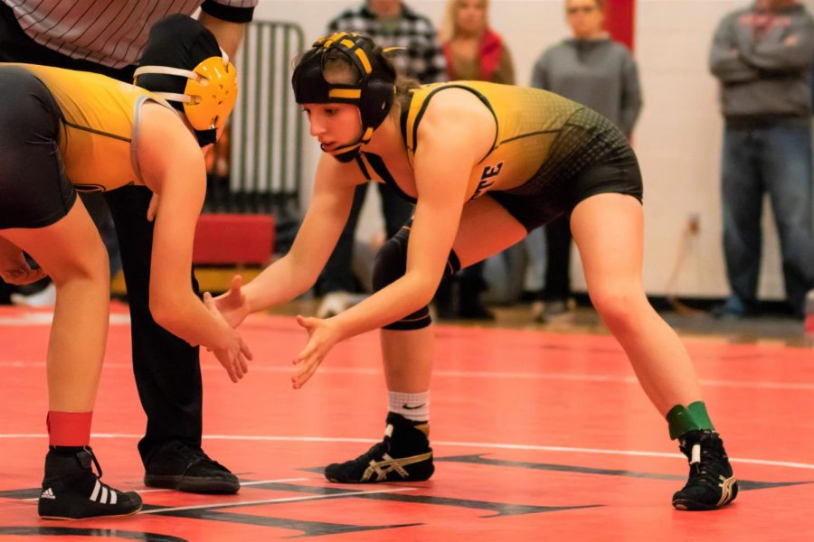 In a girls wrestling tournament at Liberty High School, defending State champ sophomore Faith Cole gets ready for a match against her opponent.