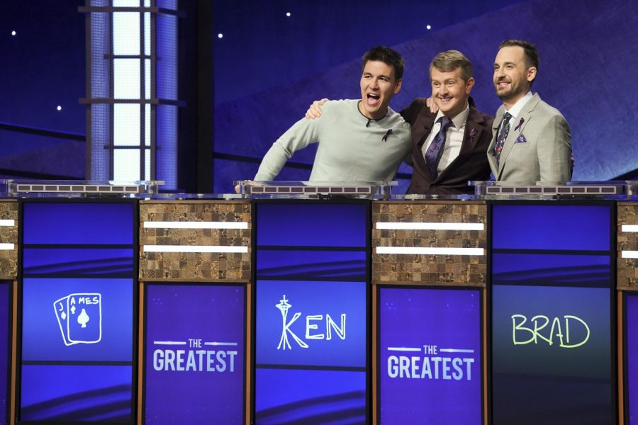 From left: James Holzhauer, Ken Jennings and Brad Rutter embrace before competing in