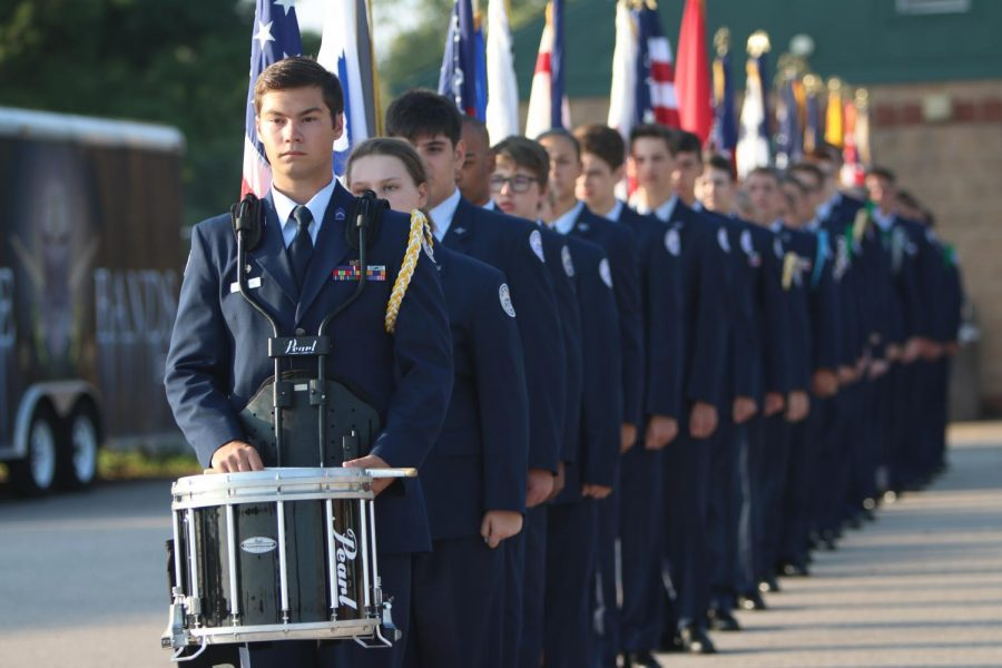 ROTC cadets line up before marching down to the flag located by the football field in order to perform the 9/11 Ceremony on Sept. 11, 2019.