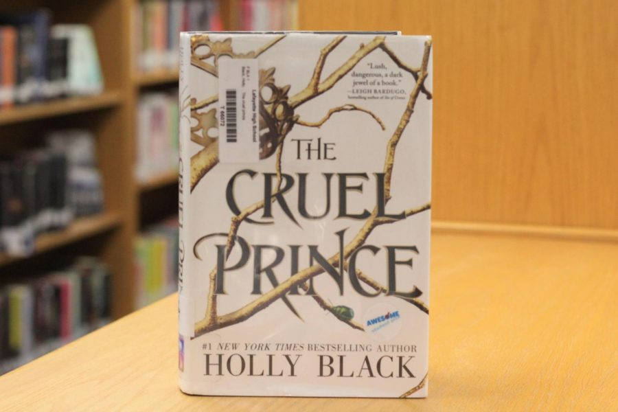 The Cruel Prince, written by Holly Black, was published in  January of 2018 and is available for checkout in the Lafayette Library.