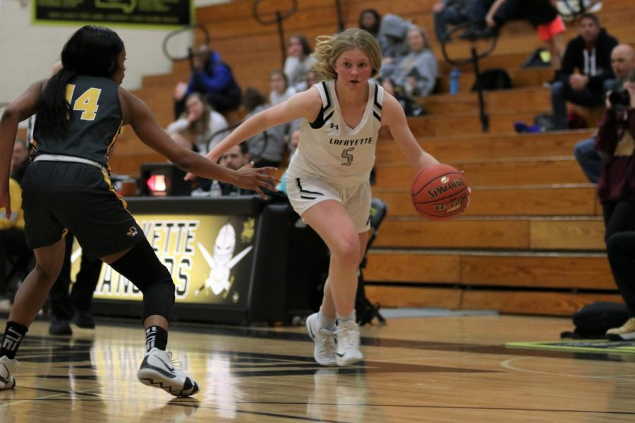 In a game against Oakville in Jan. 2020, senior Brynn Jefferies dribbles the ball past the defender. The Lady Lancers won the close match, 41-40. Already this season, the Lady Lancers have won their first game against Rockwood Summit.