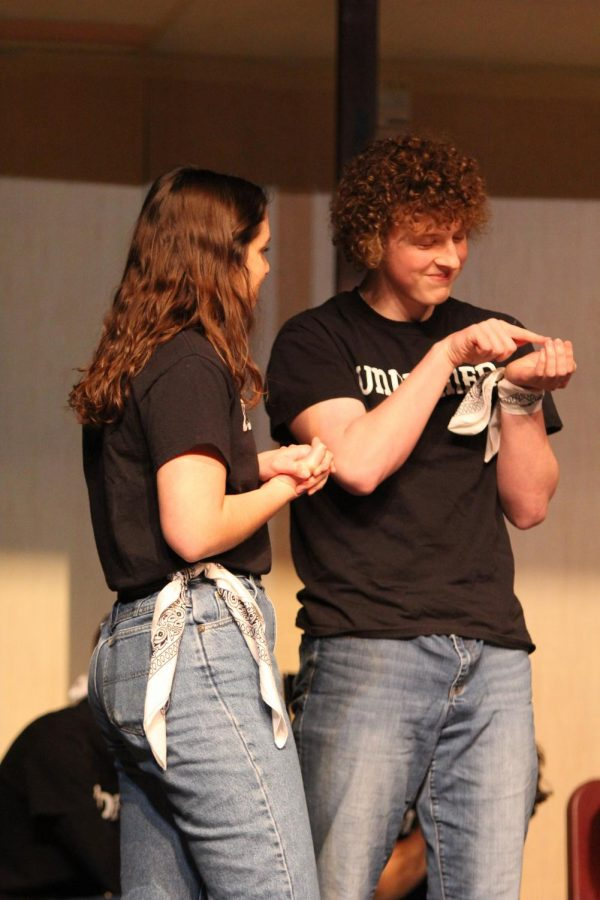 Acting as house guests, seniors Devin Zibits and Rachel Paese put on a skit together. Zibits played the role of someone who loves lizards.