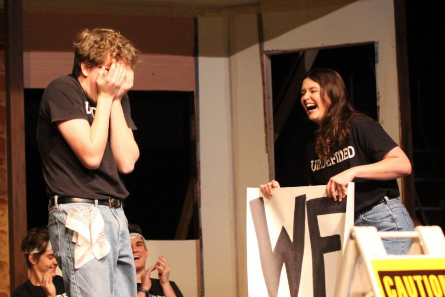 Holding a poster, senior Rachel Paese surprises senior Austin Laves by asking him to Winter Formal during the Undefined show during Flex on Jan. 22.