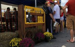 At the 2019 annual Wildwood BBQ Bash, Charlotte's Rib from Ballwin, MO held a large booth where customers could check out all kinds of foods.