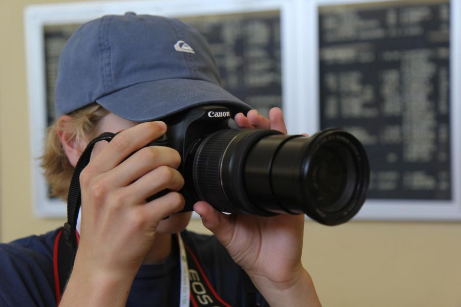 Learning+the+basics+of+photography%2C+a+journalism+student+practices+operating+a+camera+at+a+summer+Herff+Jones+STL+Yearbook+Camp+at+De+Smet+Jesuit+High+School.+Multiple+camps+are+held+each+year+for+journalism+students+to+hear+from+professionals.