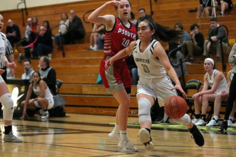 Coming out of the corner, senior guard Kayla Carpenter drives to the basket. Carpenter put up 12 points against Parkway South on Feb. 11 to help the Lancers win, 54-46.