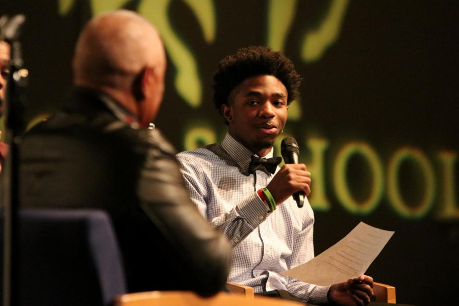 Leading the presentation, senior Isaac Dixon asks Ozzie Smith questions during the Black History Month presentation in the Theatre on Feb. 21.